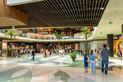 People Crowd Rush For Shopping In Luxury Mall Interior. BUCHAREST, ROMANIA - SEPTEMBER 01, 2016: People Crowd Rush For Shopping In Luxury Mall Interior Stock Photography