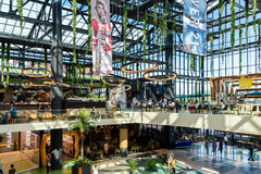 People Crowd Rush For Shopping In Luxury Mall Interior Stock Photos