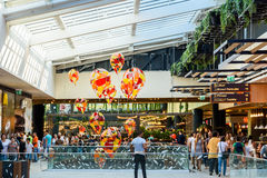 People Crowd Rush For Shopping In Luxury Mall Interior Stock Photo
