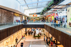 People Crowd Rush For Shopping In Luxury Mall Interior Stock Image