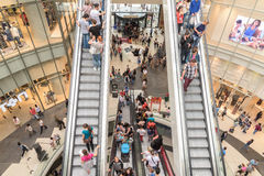 People Crowd Rush In Shopping Luxury Mall Interior Stairs. BUCHAREST, ROMANIA - JULY 16, 2015: People Crowd Rush In Shopping Luxury Mall Interior Stairs Royalty Free Stock Photos