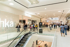 People Crowd Shopping In Luxury Mall Interior Stock Image