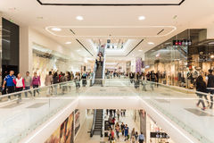 People Crowd Shopping In Luxury Mall Interior. BUCHAREST, ROMANIA - JUNE 01, 2015: People Crowd Shopping In Luxury Mall Interior Royalty Free Stock Photography