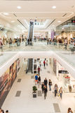 People Crowd Shopping In Luxury Mall Interior. BUCHAREST, ROMANIA - JUNE 01, 2015: People Crowd Shopping In Luxury Mall Interior Stock Photo