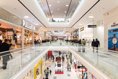 People Crowd Shopping In Luxury Mall Interior Stock Images