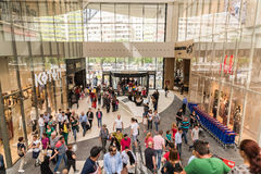 People Crowd Shopping In Luxury Mall Interior. BUCHAREST, ROMANIA - JUNE 05, 2015: People Crowd Shopping In Luxury Mall Interior Stock Photo