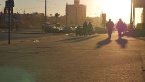 People Crowd Sunset Long Shadows Silhouettes stock video footage