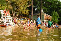 A busy summer day at the lake. People crowd Walden Pond, near Concord Massachusetts on a Summer Day Royalty Free Stock Photo