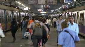 People at the crowded train station in Mumbai in the night time. MUMBAI, INDIA - 14 JANUARY 2015: People at the crowded train station in Mumbai in the night stock video