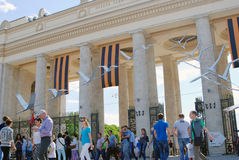 People crowds enter and leave Gorky park by the main entrance gates. Royalty Free Stock Photography