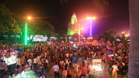 people crowds walk at festival in streets at night in Vietnam stock footage