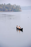 People cruising on a canoe a river of the backwaters Stock Photos