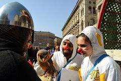 People curious of brown owl during Carnival celebration at Duomo square. Royalty Free Stock Photo