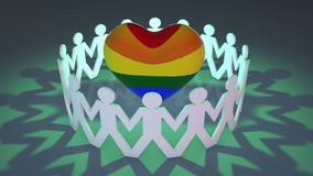 People cut outs circling rainbow heart. Cut out silhouette of people circling a rainbow colored heart showing support for the LBGT community royalty free illustration