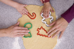 People Cutting Out Cookies Royalty Free Stock Photography