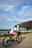 People cycle on the bridge of Marina Barrage Royalty Free Stock Image