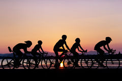 People cycling at beach Stock Images