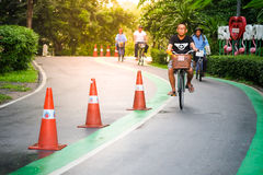 People cycling in the park. Bangkok Thailand - October 16, 2016 : People using the park, biking, recreation and healthy exercise ,Vachirabenjatas Park Rot Fai Royalty Free Stock Image