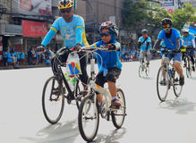 People cycling together in the event BIKE FOR MOM Stock Images