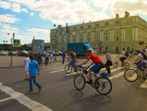 People and cyclists crossing the street. Urban everyday life in St. Petersburg. The Kutuzov Embankment. Russia. Summer 2017 Royalty Free Stock Images