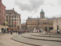 People on the Dam Square in front of  Amsterdam Royal Palace . N Royalty Free Stock Photo