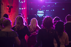 People at dance club. People dancing at a club with club lighting Stock Images
