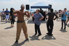 People dance on the Coney Island Boardwalk in Brooklyn Royalty Free Stock Image