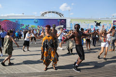 People dance on the Coney Island Boardwalk in Brooklyn Royalty Free Stock Images