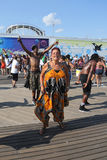 People dance on the Coney Island Boardwalk in Brooklyn Royalty Free Stock Photography