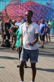 People dance on the Coney Island Boardwalk in Brooklyn Stock Photo