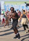 People dance on the Coney Island Boardwalk in Brooklyn Stock Photos