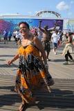 People dance on the Coney Island Boardwalk in Brooklyn Royalty Free Stock Photo
