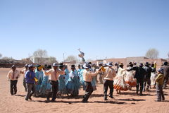 People dance at the festival in Bolivian village Stock Photo