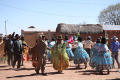 People dance at Fiesta in countryside of Bolivia, Andes Royalty Free Stock Photography