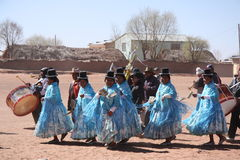 People dance during the holiday in a village of Bolivia Stock Photos