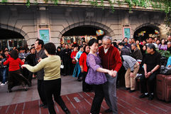 People dance for the opening of Shanghai expo. Local people dancing in NanJing road of Shanghai for the opening of Shang expo 2010 Stock Images