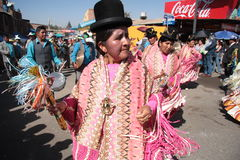 People dance and play music at carnival in Bolivia Royalty Free Stock Photos