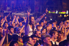 People dance during rock concert stock photo