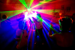 People dancing. In the disco lights Royalty Free Stock Photos