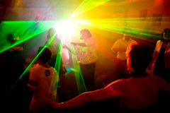 People dancing. In the disco lights Royalty Free Stock Images