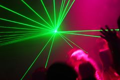 People Dancing. At the Disco with laser show royalty free stock images