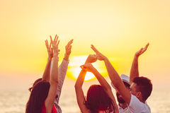 People dancing at the beach with hands up. concept about party, music and people Royalty Free Stock Photography