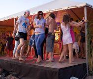 People dancing at beach on stage Royalty Free Stock Photography