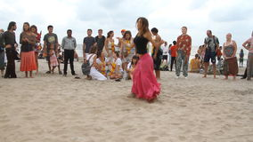People dancing on the beach stock video