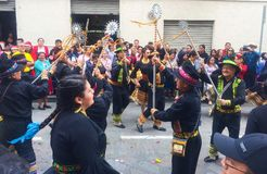 People Dancing During Christmas Parade in Cuenca Ecuador stock photos