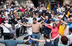 People dancing circle dance long sardana Stock Photos