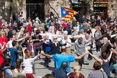 People dancing circle dance long sardana at Catedral square Stock Photos