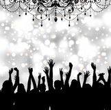 People dancing in club festive party. Black silhouettes of people raising their arms up. Silver bokeh background with lights shines and sparkles. Top hanging a Royalty Free Stock Image