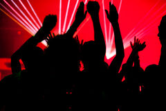 People dancing in club with laser Royalty Free Stock Photos
