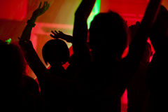 People dancing in club with laser Royalty Free Stock Image